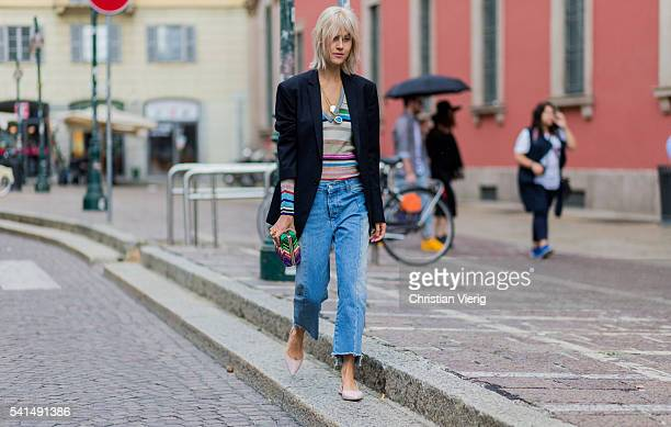 Linda Tol wearing a Missoni shirt and clutch denim jeans and a black blazer outside Missoni during the Milan Men's Fashion Week Spring/Summer 2017 on...