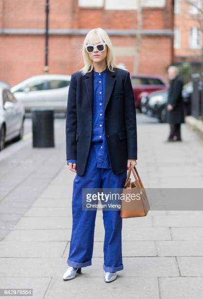 Linda Tol wearing a navy blazer blue button shirt wide leg blue pants outside Anya Hindmarch on day 3 of the London Fashion Week February 2017...