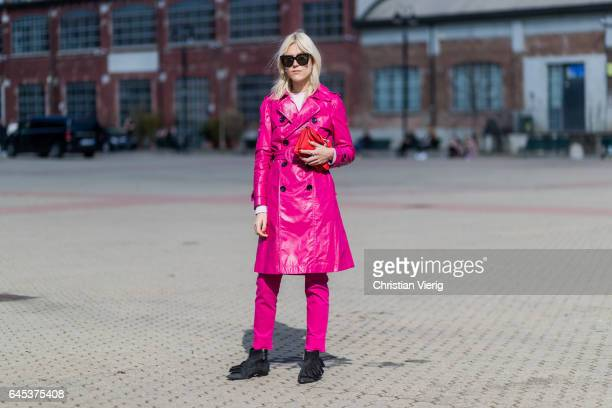 Linda Tol wearing a purple coat pants black ankle boots JW Anderson bag outside Missoni during Milan Fashion Week Fall/Winter 2017/18 on February 25...