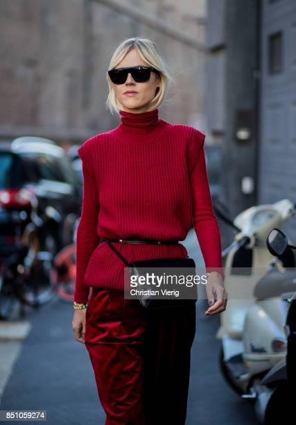 Linda Tol wearing a red knit red velvet pants is seen outside Max Mara during Milan Fashion Week Spring/Summer 2018 on September 21 2017 in Milan...