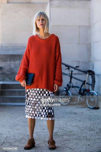 Linda Tol wearing a red sweater sequin midi skirt brown shoes and black bag is seen before the Paco Rabanne show on September 27 2018 in Paris France