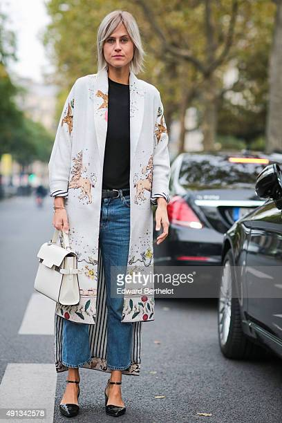 Linda Tol wearing a Sandra Mansour coat Acne Studio jeans and Top shop shoes after the John Galliano show during the Paris Fashion Week SS16 on...