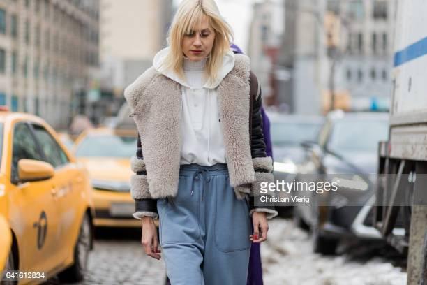 Linda Tol wearing a sheepskin jacket jogger pants white hoody outside Lacoste on February 11 2017 in New York City
