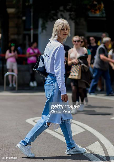 Linda Tol wearing a white Rochas sweater Ksenia Schnaider jeans and Chanel bag outside Jil Sander during the Milan Men's Fashion Week Spring/Summer...