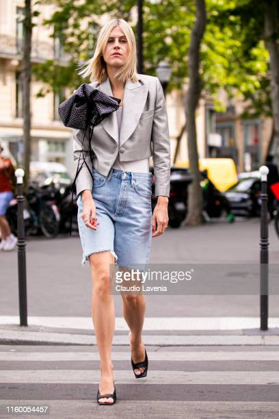 Linda Tol, wearing a white top, denim shorts, grey crop blazer with black detail and black sandals, is seen outside Schiaparelli show during Paris...