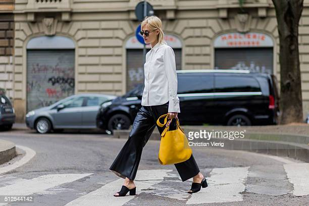 Linda Tol wearing a yellow bag a creme button shirt and black leather pants seen outside Sportmax during Milan Fashion Week Fall/Winter 2016/17 on...