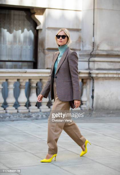 Linda Tol wearing beige pants, checkered blazer seen outside Victoria Beckham during London Fashion Week September 2019 on September 15, 2019 in...