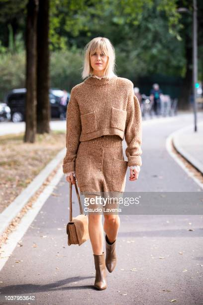 Linda Tol wearing beige sweater beige skirt and brown leather heels boots is seen before the Philosophy by Lorenzo Serafini show during Milan Fashion...