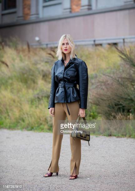 Linda Tol wearing black belted leather jacket brown pants is seen outside Samsøe Samsøe during Copenhagen Fashion Week Spring/Summer 2020 on August...