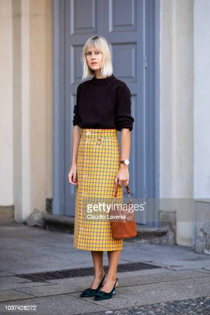 Linda Tol wearing black pullover checked skirt and Tod's bag is seen before the Tod's show during Milan Fashion Week Spring/Summer 2019 on September...
