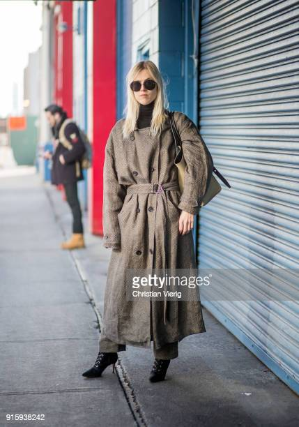 Linda Tol wearing brown belted coat seen outside Creatures of Comfort on February 8 2018 in New York City