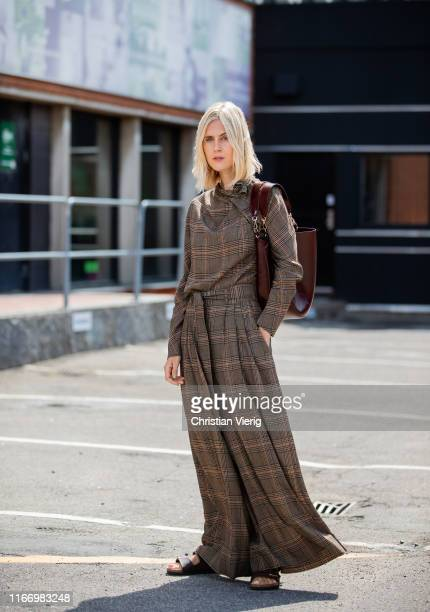 Linda Tol wearing brown plaid shirt and wide leg pants outside By Malene Birger during Copenhagen Fashion Week Spring/Summer 2020 on August 08 2019...