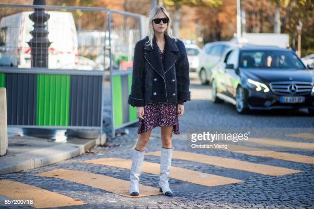Linda Tol wearing Chanel glitter boots Chanel jacket dress seen outside Chanel during Paris Fashion Week Spring/Summer 2018 on October 3 2017 in...