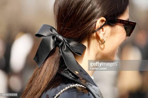 Linda Tol wearing Chanel headpiece outside Paris Fashion Week Womenswear Fall/Winter 2020/2021 Day Nine on March 03, 2020 in Paris, France.