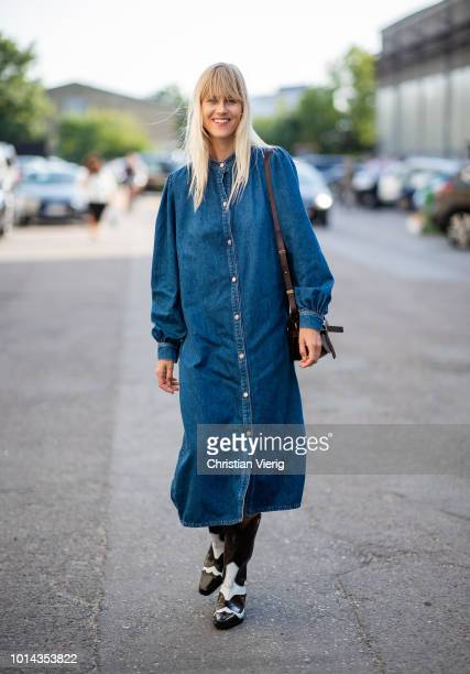 Linda Tol wearing denim dress with buttons is seen outside Ganni during the Copenhagen Fashion Week Spring/Summer 2019 on August 9 2018 in Copenhagen...