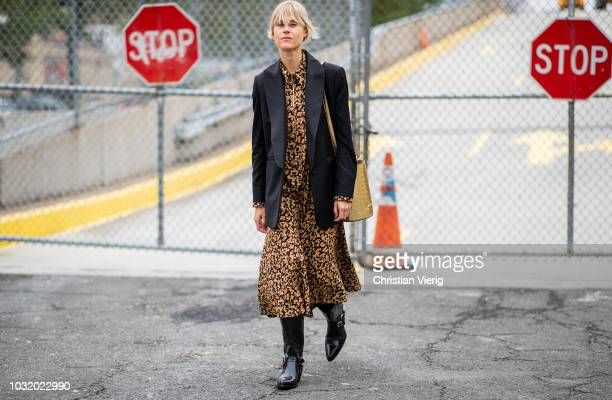 Linda Tol wearing dress with floral print black blazer jacket is seen outside Coach during New York Fashion Week Spring/Summer 2019 on September 11...