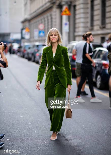 Linda Tol wearing green velvet suit seen outside Salvatore Ferragamo during Milan Fashion Week Spring/Summer 2019 on September 22 2018 in Milan Italy