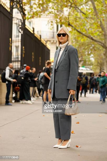 Linda Tol wearing Grey suit and Prada bag outside the Elie Saab show during Womenswear Spring/Summer 2020 show Paris Fashion Week on September 28...