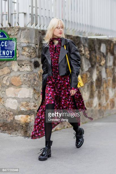 Linda Tol wearing leather jacket dress with floral print outside Loewe on March 3 2017 in Paris France