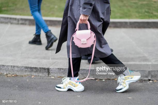 Linda Tol wearing Louis Vuitton sneakers is seen outside Armani during Milan Fashion Week Fall/Winter 2018/19 on February 25 2018 in Milan Italy