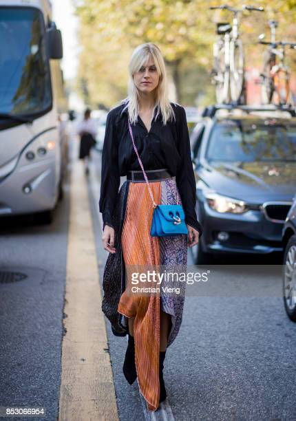 Linda Tol wearing maxi skirt blue JW Anderson bag black blouse is seen outside Marni during Milan Fashion Week Spring/Summer 2018 on September 24...