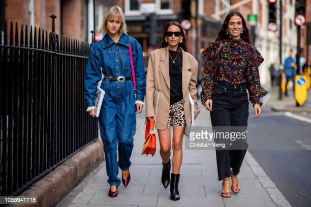 Linda Tol wearing overall, Chloe Harrouche and Erika Boldrin is seen outside JW Anderson during London Fashion Week September 2018 on September 15,...