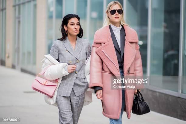 Linda Tol wearing pink coat seen outside SelfPortrait on February 10 2018 in New York City