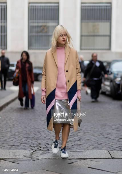 Linda Tol wearing pink knit beige coat silver skirt JW Anderson bag white sneaker outside Salvatore Ferragamo during Milan Fashion Week Fall/Winter...