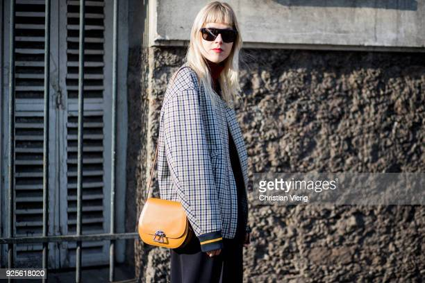 Linda Tol wearing plaid jacket is seen outside Lacoste on February 28 2018 in Paris France