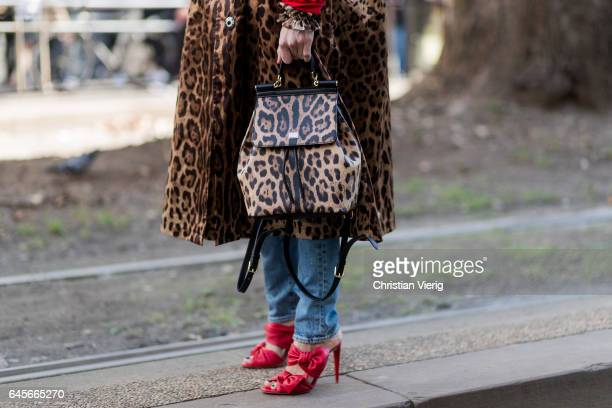 Linda Tol wearing red hoody and leopard print coat and backpack red heels outside Dolce Gabbana during Milan Fashion Week Fall/Winter 2017/18 on...