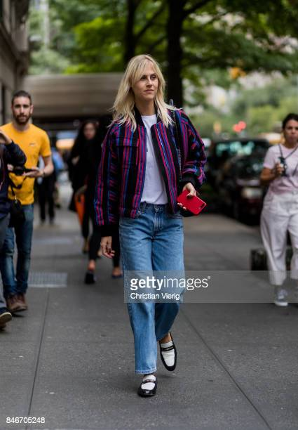 Linda Tol wearing striped jacket, denim jeans seen in the streets of Manhattan outside Marc Jacobs during New York Fashion Week on September 13, 2017...