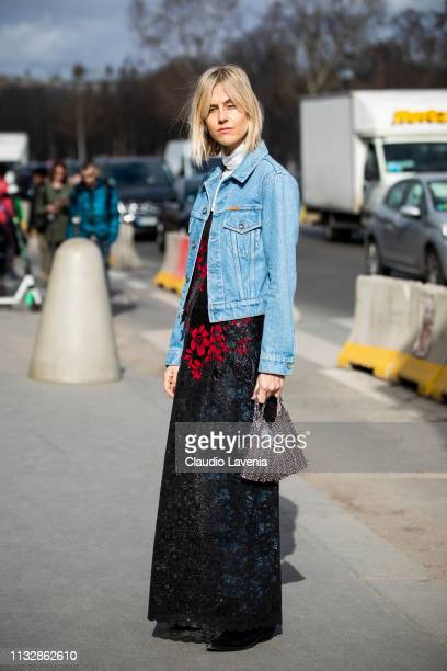 Linda Tol wearing wearing a long decorated dress silver bag and blue denim jacket is seen outside Paco Rabanne on Day 4 Paris Fashion Week...