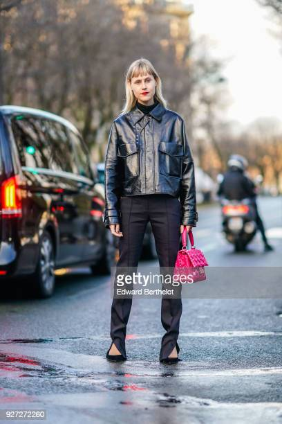 Linda Tol wears a black leather jacket a pink bag black pants outside Valentino during Paris Fashion Week Womenswear Fall/Winter 2018/2019 on March 4...