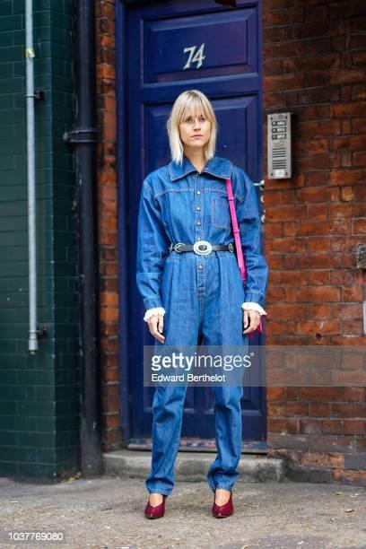 Linda Tol wears a blue denim jumpsuit during London Fashion Week September 2018 on September 15 2018 in London England