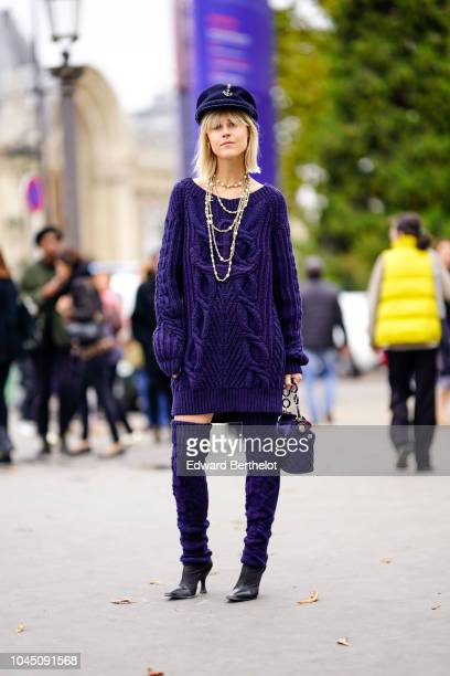 Linda Tol wears a blue hat a blue wool pullover dress thigh high boots outside Chanel during Paris Fashion Week Womenswear Spring/Summer 2019 on...