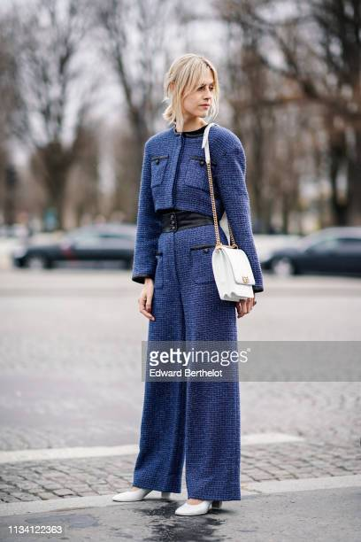 Linda Tol wears a blue tweed jacket a white bag flared pants white shoes outside Chanel during Paris Fashion Week Womenswear Fall/Winter 2019/2020 on...