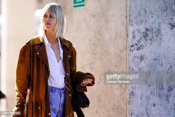 Linda Tol wears a brown suede coat during Paris Fashion Week Womenswear Spring/Summer 2019 on September 26 2018 in Paris France