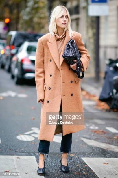 Linda Tol wears a camel coat a bag pants shoes outside Valentino during Paris Fashion Week Womenswear Spring/Summer 2018 on October 1 2017 in Paris...