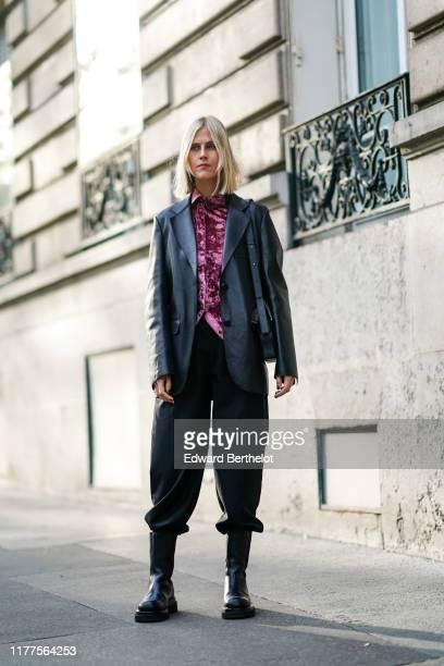 Linda Tol wears a pink crushed velvet shirt, a black leather jacket, a black bag, black pants, black flat boots, outside Alessandra Rich, during...
