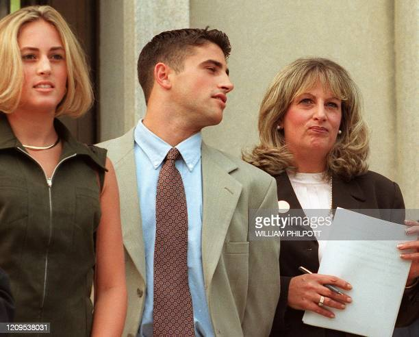 Linda Tripp waits to make a statement to reporters beside her daughter Allison and son Ryan in front of the Federal Courthouse 29 July in Washington...
