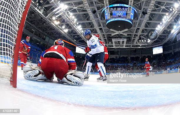 Linda Valimaki of Finland scores against Anna Prugova of Russia in the first period during the Women's Classifications Game on day 11 of the Sochi...