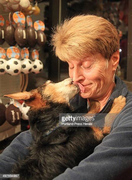 Linda Walton of Saco is showered with kisses from Beau her 12 yearold Yorkie/Dachshund mix the returning champion of the Planet Dog Valentine's Day...