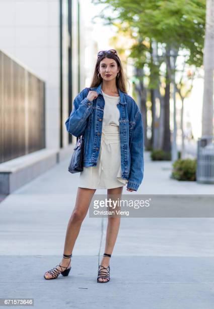 Linda wearing a denim jacket wite dress sandals on April 21 2017 in Los Angeles California