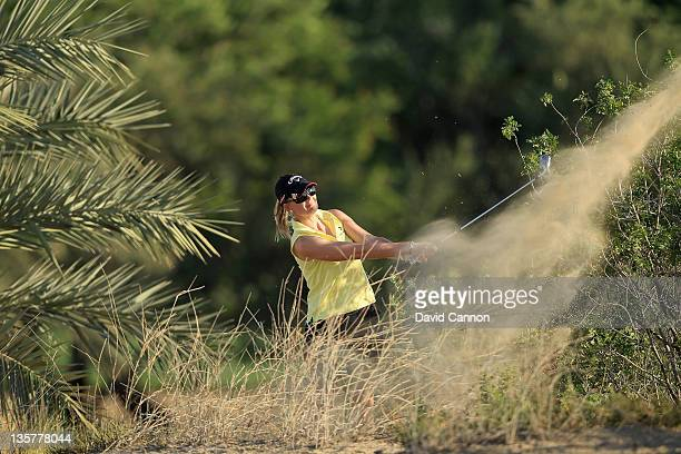 Linda Wessberg of Sweden plays her third shot at the par 4, 8th hole during the first round of the 2011 Omega Dubai Ladies Masters on the Majilis...