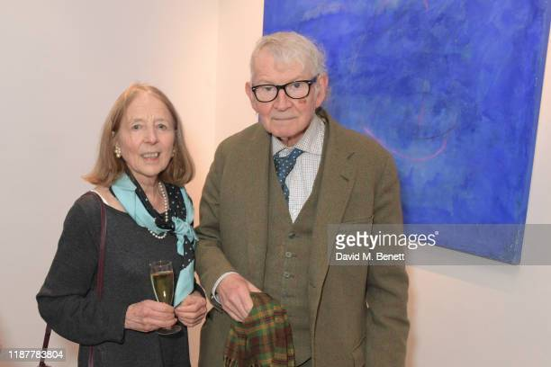 Linda Whiteley and Jon Whiteley attend a private view of 'Into The Blue' by artist Irene Petrafesa at AD Gallery on December 10 2019 in London England