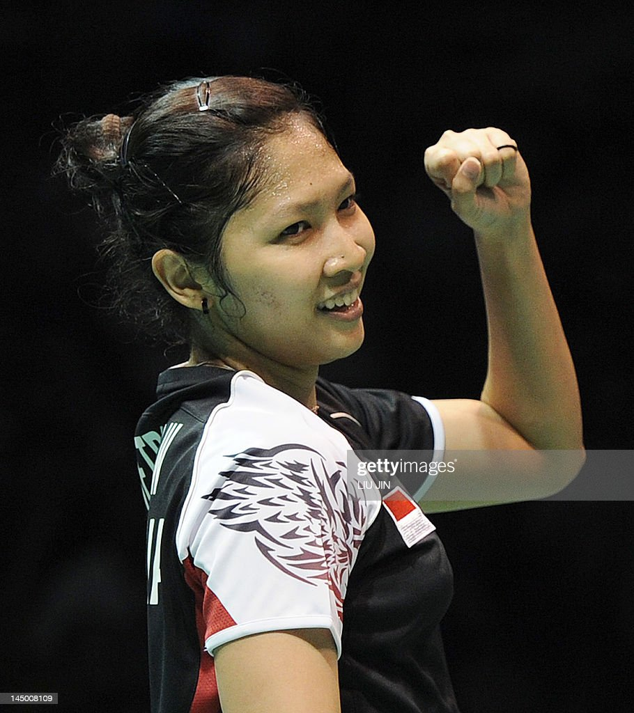 Lindaweni Fanetri of Indonesia reacts to a winning point against Wang Shixian of China during the Group A match at the Uber Cup world badminton team championships in China's central city of Wuhan, in Hubei province on May 22, 2012. Wang Shixian won the match.