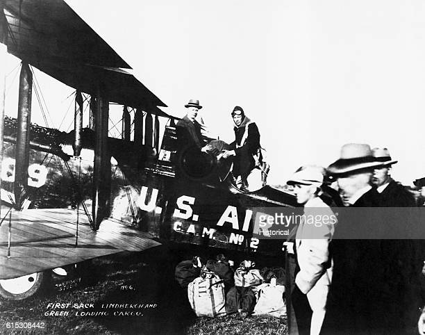 Lindbergh and Green load the first sacks of mail to go on the inagural flight of contract air mail from St. Louis to Chicago. Lambert Field, St....