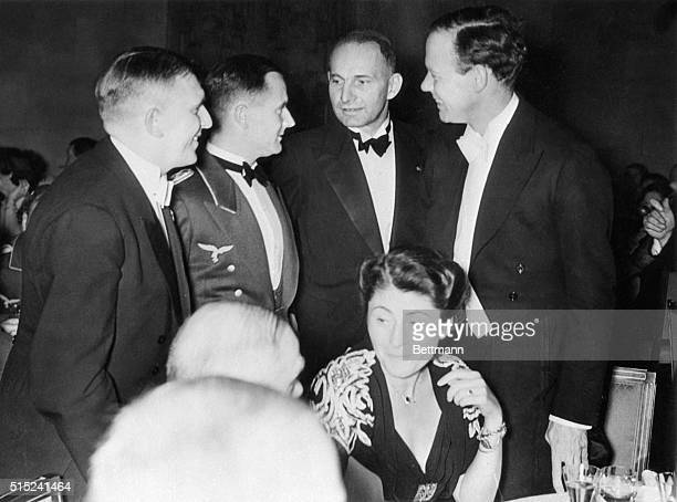 Lindbergh at Nazi Air Party. Berlin, Germany: Colonel Charles A. Lindbergh, is shown chatting with high-ranking men of Nazi aviation at the dinner...