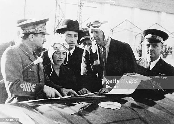Lindberghs Receive Guidance from General Balbo. Tripoli, Libya: General Italo Balbo, left, governor general of Libya, is shown as he gave...