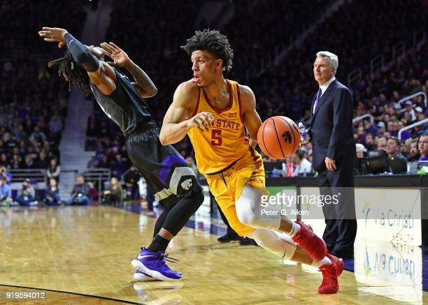 Lindell Wigginton of the Iowa State Cyclones drives around Cartier Diarra of the Kansas State Wildcats during the first half on February 17 2018 at...